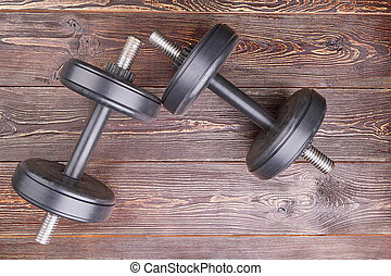 Two black dumbbells, top view.