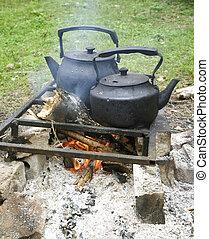 Two black kettle