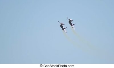 Two black military fighter jets flying in circles in the...