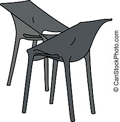 Two black plastic chairs