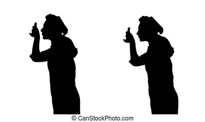 Two black silhouettes of cook girl trying dish of ladle. -...