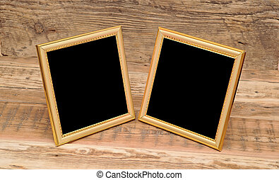 two blank photo frame on old table