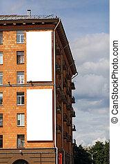 Two blank vertical billboards