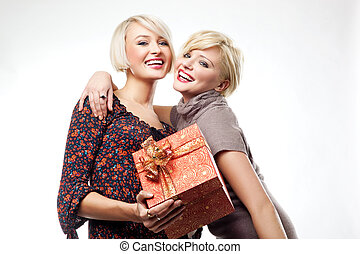 Two blond beauties holding a christmas present