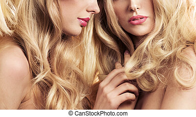 Two blond women in a beauty salon