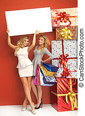 Two blond women with plenty of gifts