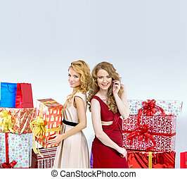 Two blondies holding Christmas presents