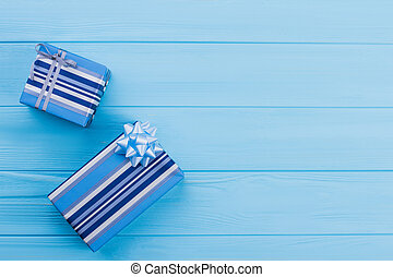 Two blue striped gift boxes.