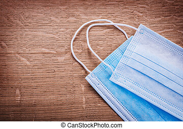two blue surgical mask on wooden board medical concept