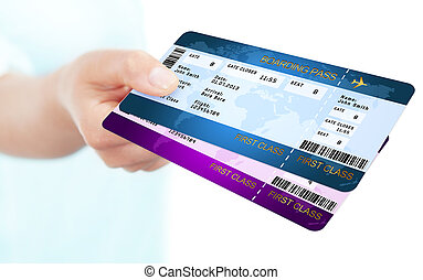 two boarding pass tickets holded by hand over white...