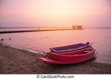 two boat in lake at the sunrise