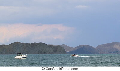 Two Boats Floating In The Sea At Mountains