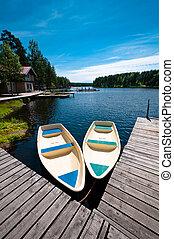 Two boats floating near pier