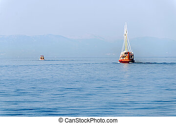 Two boats travelling away