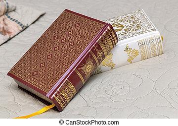 Two books in beautiful bindings.
