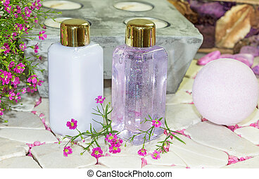 Two bottles of floral perfume