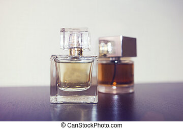 Two bottles of perfume on the table.