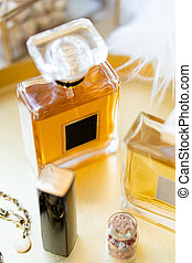 Two bottles of perfume with blank labels and luxurious beauty accessories