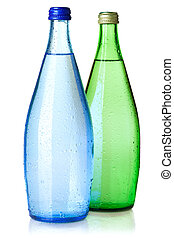 Two bottles of soda water with water drops. Isolated on...