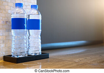 two bottles of water on the table