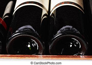 Two bottles on rack