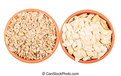 Two bowls sunflower seeds and pumpkin isolated on white background.