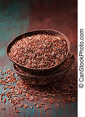 Two bowls with red rice