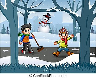 Two boy cleaning snow on the road