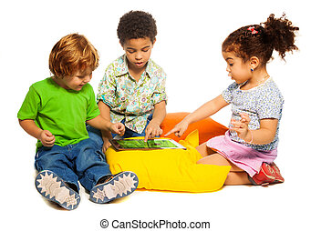 Two boys and girl playing with tablet