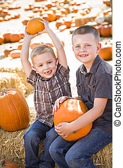 Two Boys at the Pumpkin Patch Talking and Having Fun - Two...