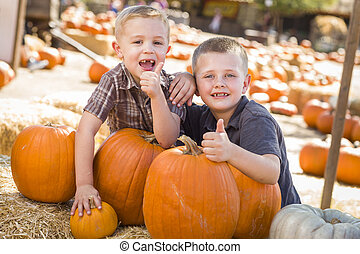 Two Boys at the Pumpkin Patch with Thumbs Up