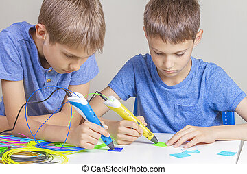 Two boys creating with 3d printing pens
