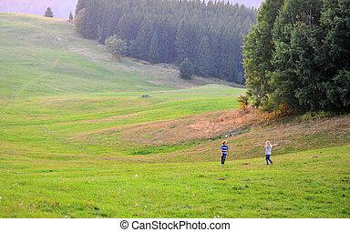 Two boys having fun in grass field