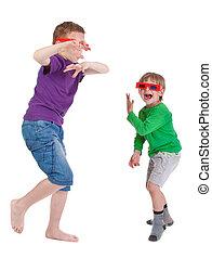 two boys having fun wearing 3D glasses