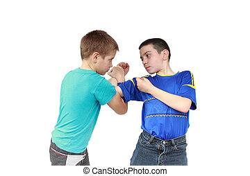 On a white background two boys in sportswear clothing is performing tricks