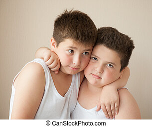 two boys in t-shirts hugging