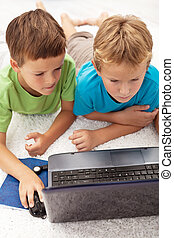 Two boys in the heat of a computer game