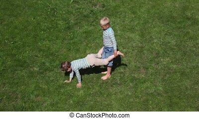 two boys playing wheelbarrow