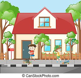 Two boys raking leaves in front of house