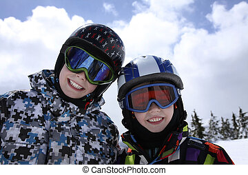 two boys skiing - two young boys in skiing outfit