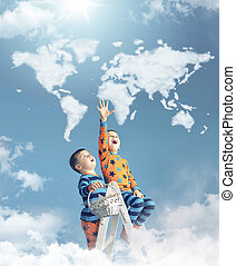 Two boys touching a world map
