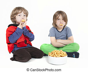 two boys with peanut puffs