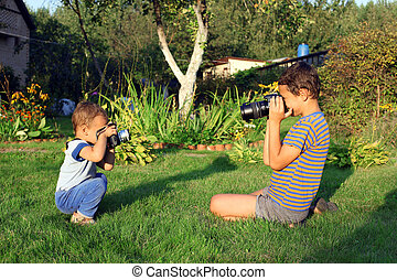 two boys with vintage photo camera