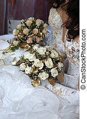 two brides holding wedding bouquet in hands