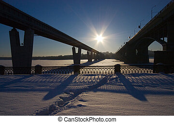 two bridges and sun