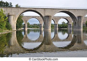 Two bridges in perfect harmony - Two bridges crossing the...