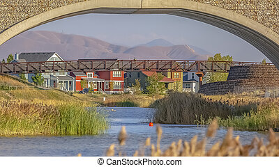 Two bridges over Oquirrh Lake seen on a sunny day