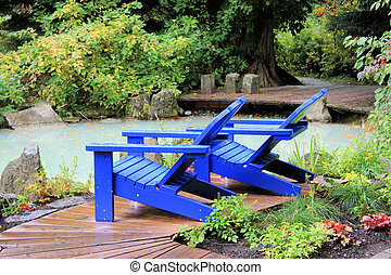Adirondack Chairs - Two Bright Blue Adirondack Chairs on the...