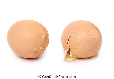 Two broken eggs isolated on white background