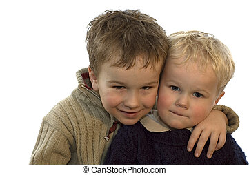Two lovely brothers, 5 and 2 years of age. On white background.